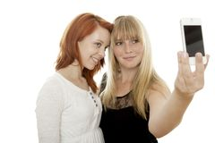 Young beautiful red and blond haired girls Stock Photo