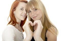 Young beautiful red and blond haired girls  formin Royalty Free Stock Photo