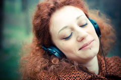 Young beautiful red curly hair woman Stock Images