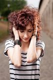 Young beautiful red curly hair woman at the park looking down Royalty Free Stock Image