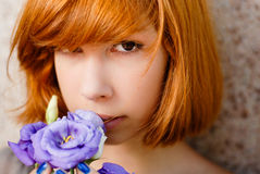 Young beautiful red hair girl & purple rose Stock Photography