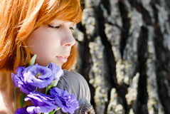 Young beautiful red hair woman & chinese rose Royalty Free Stock Image