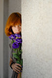 Young beautiful red hair woman holding purple chinese rose copy Royalty Free Stock Photography