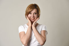 Young beautiful red hair woman smiling happy and cheerful in friendly joyful face expression Royalty Free Stock Photos