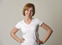 Young beautiful red hair woman smiling happy and cheerful in friendly joyful face expression Royalty Free Stock Images