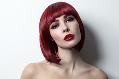 Young beautiful red-haired girl with bob haircut and Stock Images