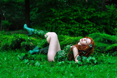 Young beautiful red-haired girl in the image of the comic book poison ivy Royalty Free Stock Image