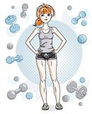 Young beautiful red-haired sporty woman standing on simple backg. Round with dumbbells and barbells. Vector character wearing shorts and T-shirt. Sport and Stock Images