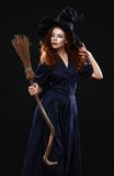 Young beautiful red-haired witch in the dark Royalty Free Stock Photos