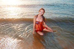 Young beautiful redhair girl in azure bikini and Royalty Free Stock Photo