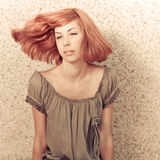 Young beautiful redhaired teenage girl playing with hair Stock Photography