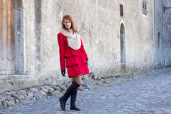 Young beautiful redhaired woman walking in Tallinn Stock Photo