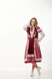 Young beautiful redhead folk dancer woman with gorgeous long hair in traditional authentic folk costume posing isolated on white. Young beautiful redhead folk stock images
