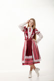Young beautiful redhead folk dancer woman with gorgeous long hair in traditional authentic folk costume posing isolated on white. Young beautiful redhead folk stock photos