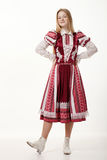 Young beautiful redhead folk dancer woman with gorgeous long hair in traditional authentic folk costume posing isolated on white. Young beautiful redhead folk royalty free stock photography