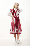 Young beautiful redhead folk dancer woman with gorgeous long hair in traditional authentic folk costume posing isolated on white. Young beautiful redhead folk stock photography