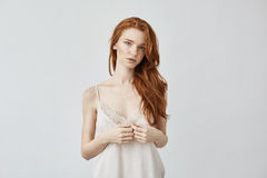 Young beautiful redhead girl posing looking at camera. Royalty Free Stock Image