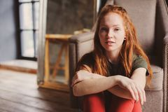 Young beautiful redhead hipster woman with no make up relaxing at home royalty free stock photo