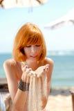Young beautiful redhead woman in bikini on sea. Young beautiful redhead woman portrait outdoors in bikini on sea coast stock photography