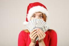 Gorgeous redhead female wearing Santa`s hat with pop-pom, celebrating winter festive season holidays. royalty free stock images