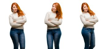 Young beautiful redhead woman isolated over white background royalty free stock photo