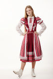 Young beautiful redhead woman dancer in traditional folk costume posing isolated on white background Stock Photo