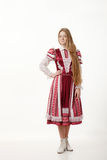 Young beautiful redhead woman dancer in traditional folk costume posing isolated on white background Royalty Free Stock Photos
