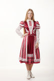 Young beautiful redhead woman dancer in traditional folk costume posing isolated on white background Stock Photography