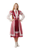 Young beautiful redhead woman dancer in traditional folk costume posing isolated on white background Royalty Free Stock Images