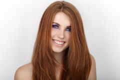 Young beautiful redhead woman with gorgeous hair and violet eyes makeup smiling Stock Photos