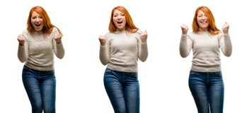 Young beautiful redhead woman  over white background. Young Beautiful redhead woman happy and excited expressing winning gesture. Successful and celebrating Royalty Free Stock Photo