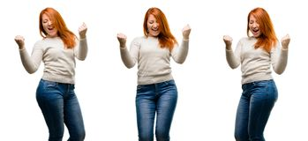 Young beautiful redhead woman  over white background. Young Beautiful redhead woman happy and excited expressing winning gesture. Successful and celebrating Royalty Free Stock Photography