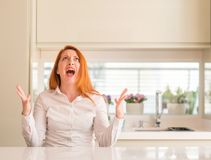 Young beautiful redhead woman at home stock image