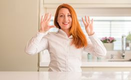 Young beautiful redhead woman at home royalty free stock photo
