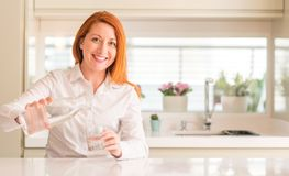 Young beautiful redhead woman at home royalty free stock image