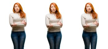 Young beautiful redhead woman isolated over white background stock image