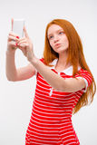 Young beautiful redhead woman  taking selfie and making duck face Stock Photography