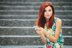 Young beautiful redhead woman texting Stock Image