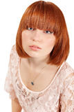 Young beautiful redheaded teen girl. Isolated on white background Stock Photo