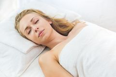 Young beautiful and relaxed lady in spa treatment Stock Image