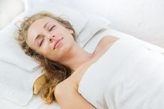 Young beautiful and relaxed lady in spa treatment Royalty Free Stock Photo