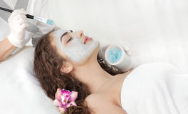 Young Beautiful Relaxing Woman Having Moistening Mask Applied Stock Photography