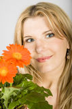 Young beautiful retro woman with flowers in a pot Stock Photo