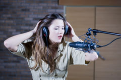 Young beautiful retro woman recording the sound Stock Photo