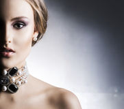 Young, beautiful and rich woman in jewels Stock Photos