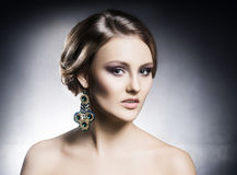Young, beautiful and rich woman in jewels Royalty Free Stock Images
