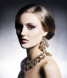 Young, beautiful and rich woman in jewels Royalty Free Stock Photos