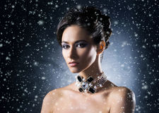 Young, beautiful and rich woman in jewels Royalty Free Stock Image