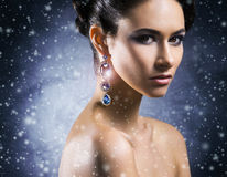 Young, beautiful and rich woman in jewels Stock Images