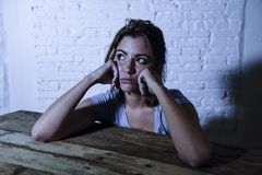 Young beautiful sad and depressed woman looking wasted and frustrated suffering pain and depression feeling low and break down Royalty Free Stock Photo